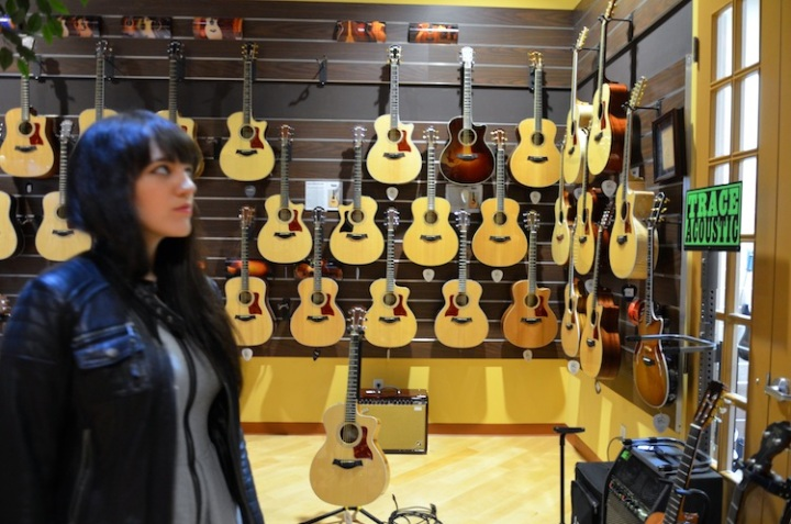 looking at acoustic guitars
