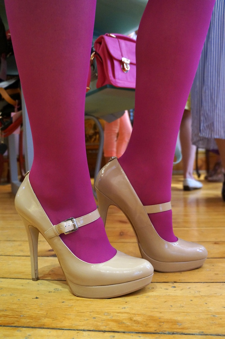 Nude Michael Kors pumps with hot pink tights