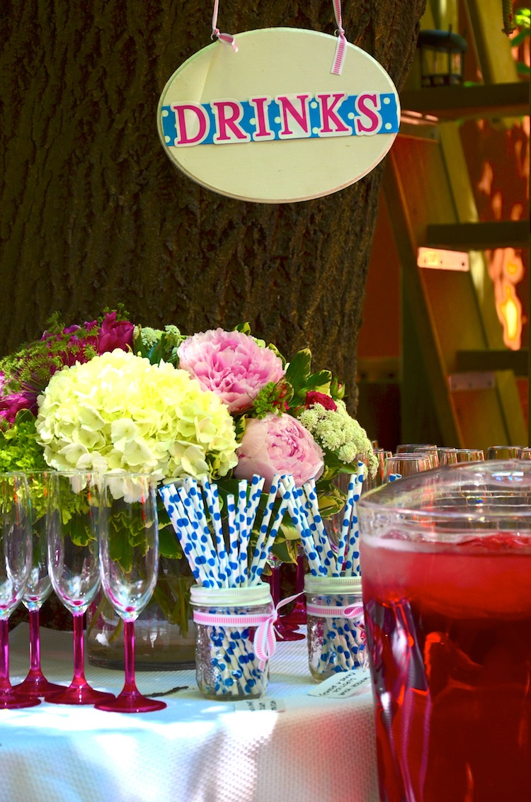 Pretty drinks table with flowers and fun straws