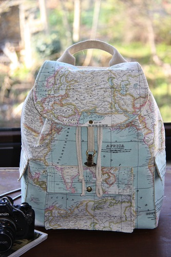 world map traveler backpack