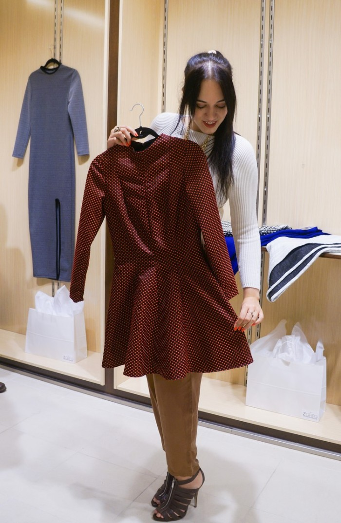 Sage (Trendy Techie) sizing up a Zafira dress from the fall collection